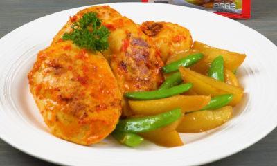 Satu porsi ayam cincane dengan sayuran tersaji di atas piring putih.
